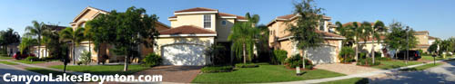 Beautiful, well-kept homes and yards are to be found within the gates of Boynton Beach's Canyon Lakes.